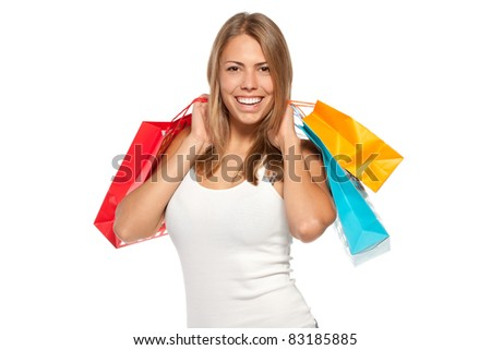 Young happy female holding shopping bags with purchases over white background - stock photo