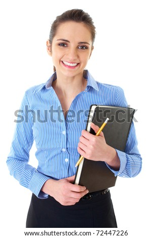 young happy female in blue shirt holds black notepad and yellow pencil, isolated on white - stock photo