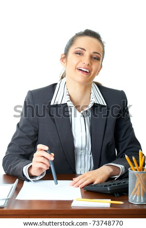 young happy female office worker sits at her desk, isolated on white background