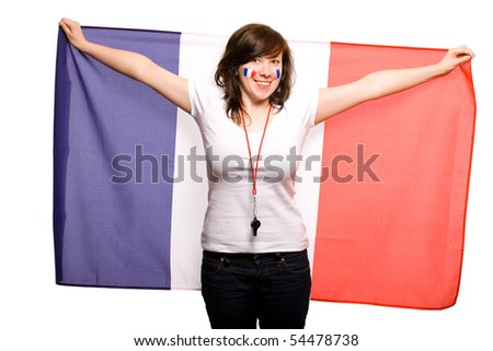 young happy female supporter of french team, isolated on white background, she also has her cheeks painted with french flags
