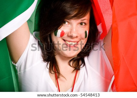 young happy female with italian flag as background, also italian flags on her cheeks