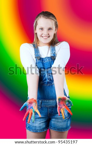 young happy girl.  Child hands painted in colorful paints. Children's hand in the paint  on colorful background - stock photo
