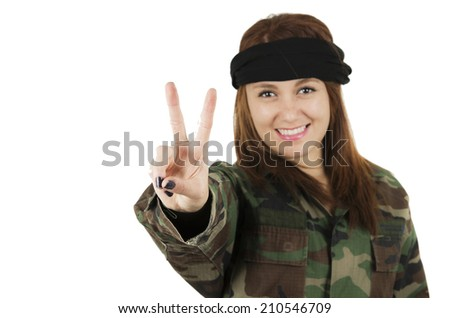 Young happy girl dressed in green camouflage jacket gesturing peace with fingers isolated on white - stock photo