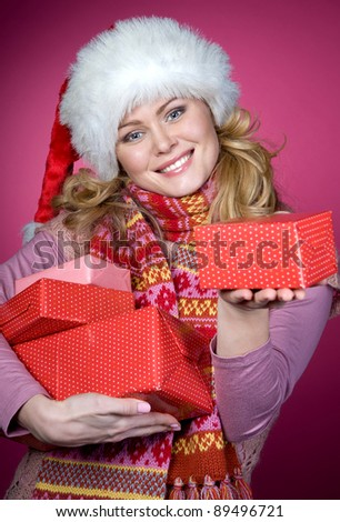 Young happy girl in Christmas hat. - stock photo