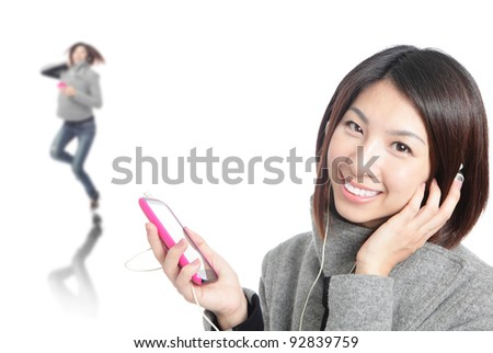 Young Happy Girl listen music with earphones by mobile phone isolated on white background, model is a asian beauty - stock photo