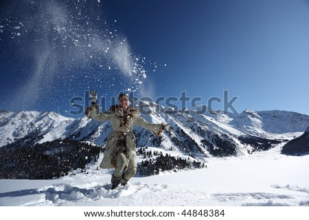 young happy girl plays with a snow - stock photo