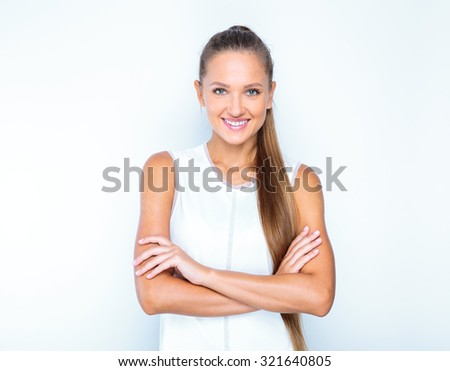 young happy girl posing in studio to get a perfect portrait business shot - stock photo