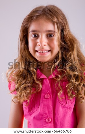 young happy girl smiling, close up portrait - stock photo
