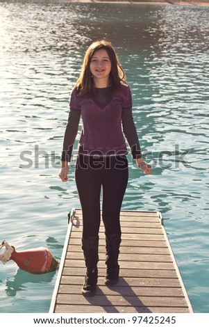 Young Happy Girl Standing On A Pier - stock photo