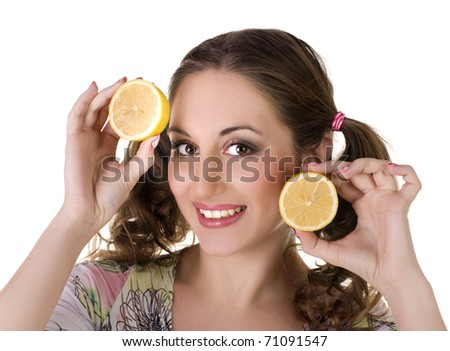 Young happy girl with lemon in her hands