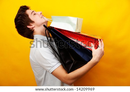 young happy handsome man with presents - stock photo