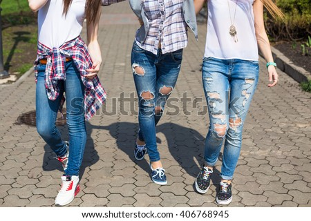 Young happy hipster teenage girls having fun in summer park. - stock photo