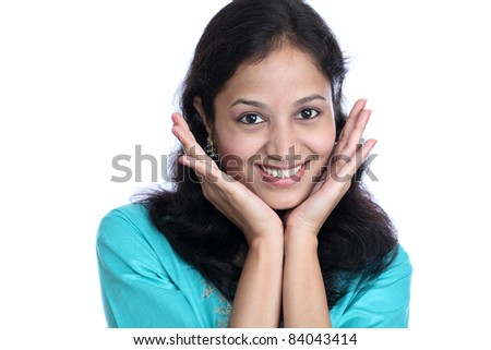 Young happy indian woman with hands on chin - stock photo