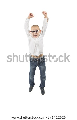 Young happy kid jumping in the air against a white background - stock photo