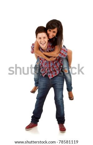 Young happy latin couple playing together piggyback isolated on white background - stock photo