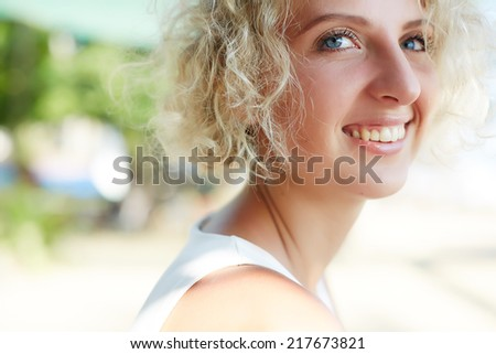 Young happy laughing girl on the street - stock photo