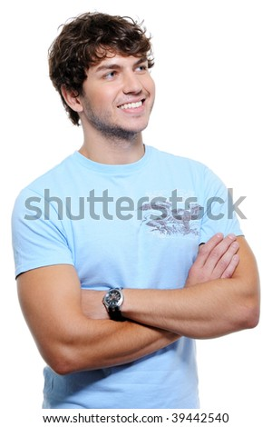 Young happy laughing handsome man looking away - portrait - stock photo