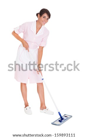 Young Happy Maid Cleaning Floor With Mop Over White Background - stock photo