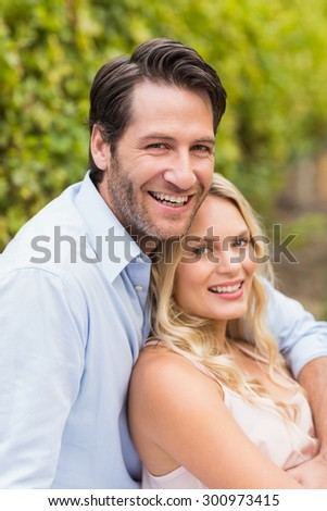 Young happy man embracing his girlfriend in the grape fields