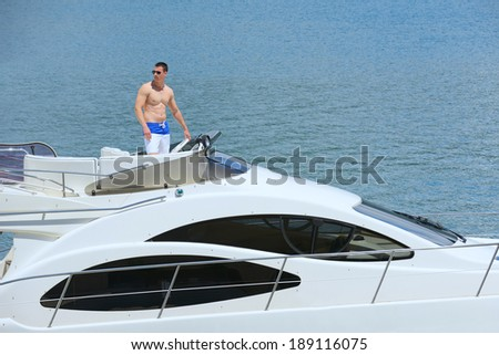 young happy man have fun on luxury boat yacht