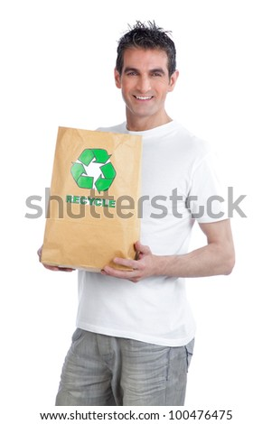 Young happy man holding shopping paper bag.