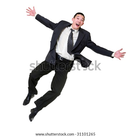 Young happy man in a business suit jumps upwards, isolated on a white background - stock photo