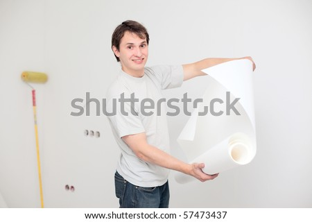 young happy man making renovation of his apartment - stock photo