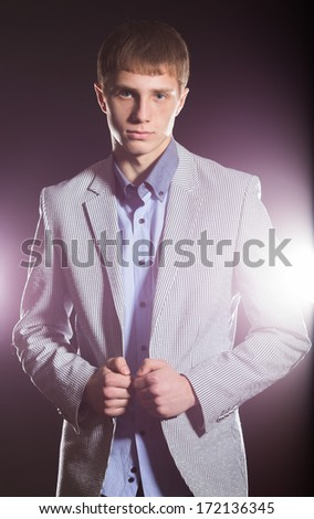 Young Happy Man Over a Black Background - stock photo