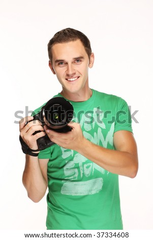 Young happy man with camera. - stock photo