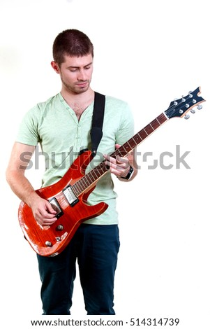 Young happy man with guitar on white