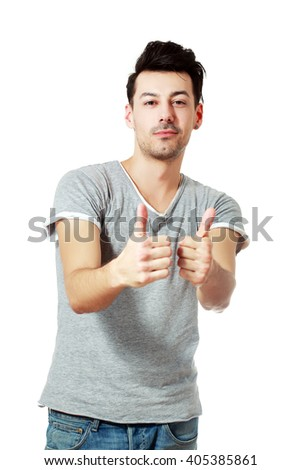 Young happy man with thumbs up sign in casuals isolated on white background. - stock photo