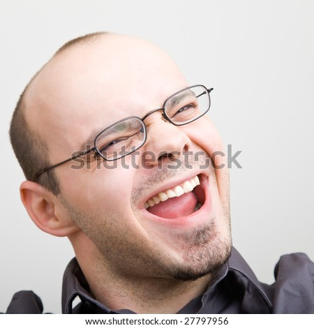 Young happy man yelling loud - stock photo