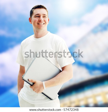 Young happy men or student with laptop on the business background