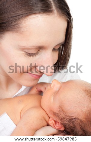 Young happy mother look at her baby on white background