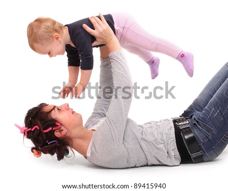 Young happy mother playing with her child.
