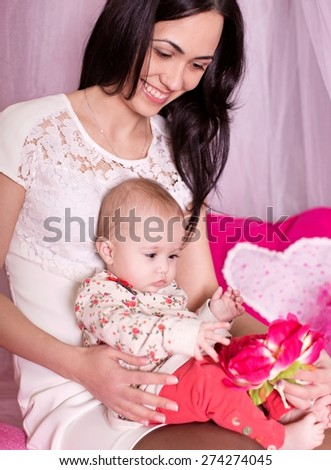Young happy mother with baby - stock photo
