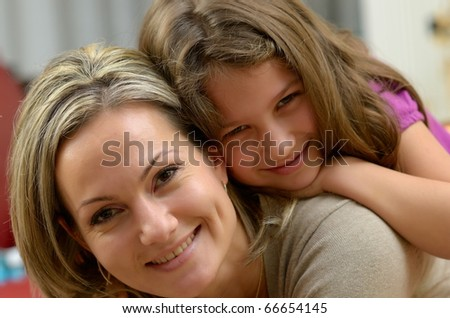 young happy mother with her daughter