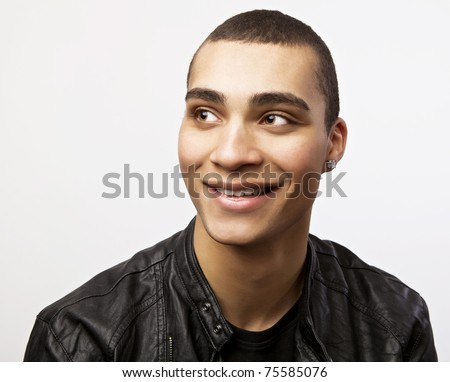 Young happy mulatto in a leather jacket. Portrait with smile. - stock photo