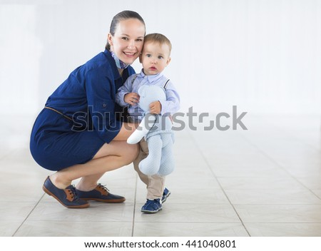 Young happy mummy and her kid on a white background - stock photo