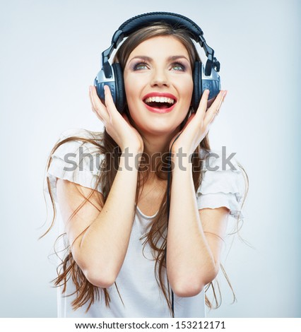 Young Happy Music woman isolated portrait. Female model studio isolated. Beautiful girl. - stock photo
