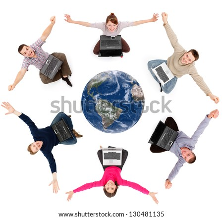 Young happy people sitting around Earth globe with laptops (Elements of this image furnished by NASA) - stock photo