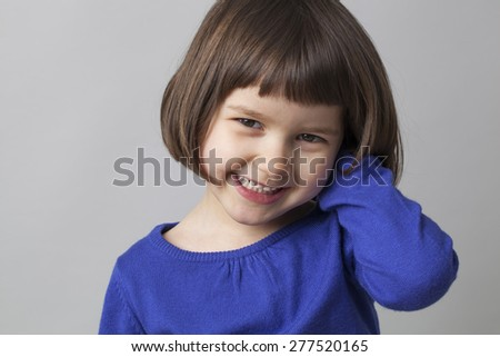 young happy preschool girl smiling in front of the camera for happiness - stock photo