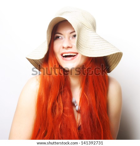 young happy redhair woman with hat