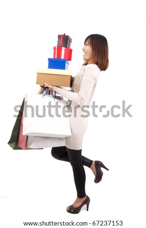 Young happy shopping woman with a lot of gift box and shopping bag - stock photo