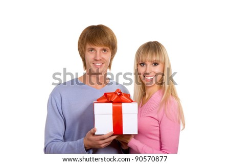 Young happy smile couple, hold christmas or valentine gift box, isolated over white background - stock photo