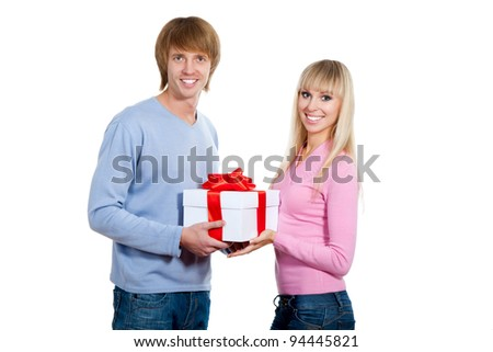 Young happy smile couple, hold gift box, looking at camera, isolated over white background - stock photo