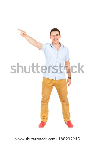 young happy smile man standing hold pointing finger up to side with emptry copy space, handsome guy wear shirt, full length isolated over white background - stock photo