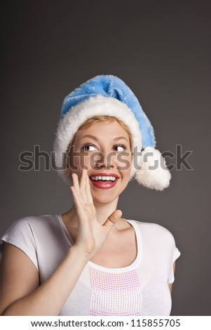 young happy smile woman wear santa clause costume loud screaming, calling out to someone, attractive christmas new year party girl looking at camera hold hand open palm - stock photo