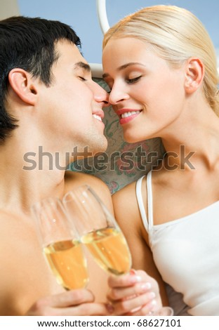 Young happy smiling amorous couple with champagne, celebrating