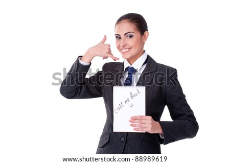 Young happy smiling business woman with call me gesture